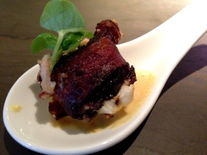 Bacon wrapped date, feta and spicy mustard