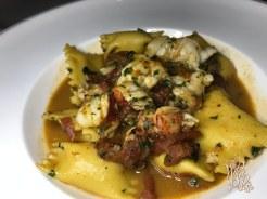 Corn Agnolotti in a roasted lobster sauce